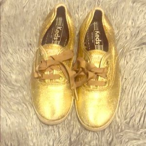 Gold low top KEDS shoes